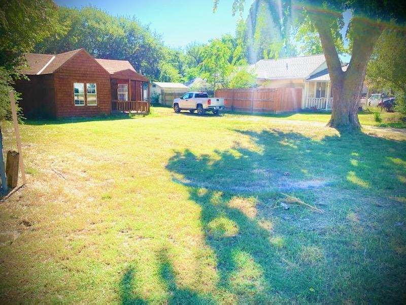 This ranch home is located on a large lot, which includes drives to both the front and back entrance