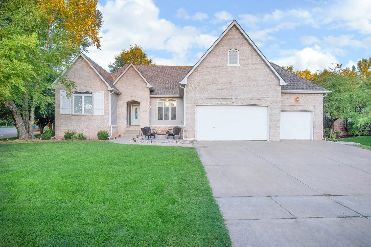 5 BEDROOM RANCH IN THE MAIZE DISTRICT WITH UPGRADES GALORE!  WALK INTO A LARGE LIVING ROOM WITH GREA