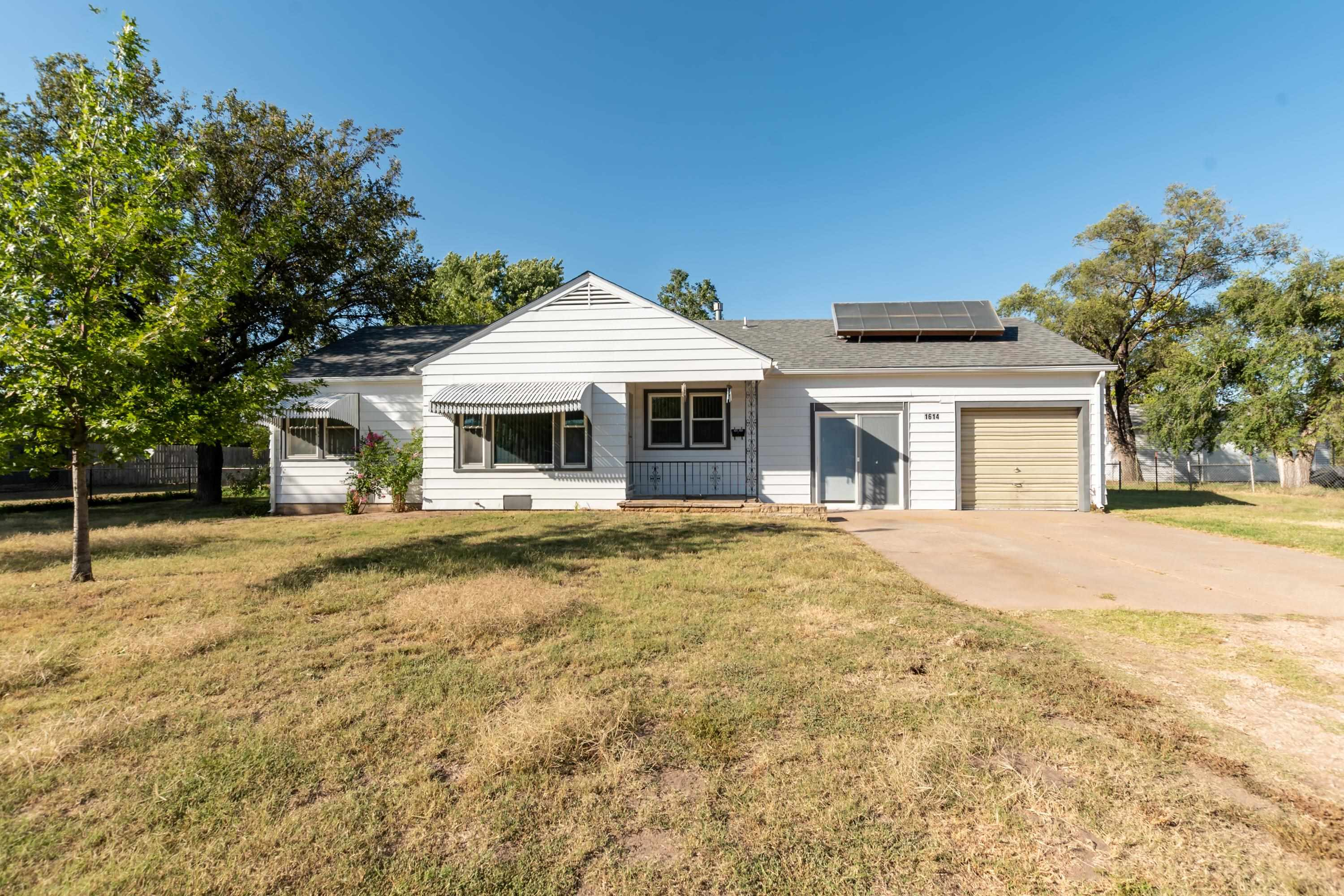 Well cared for home on almost half an acre in south Wichita! This spacious home with a very function