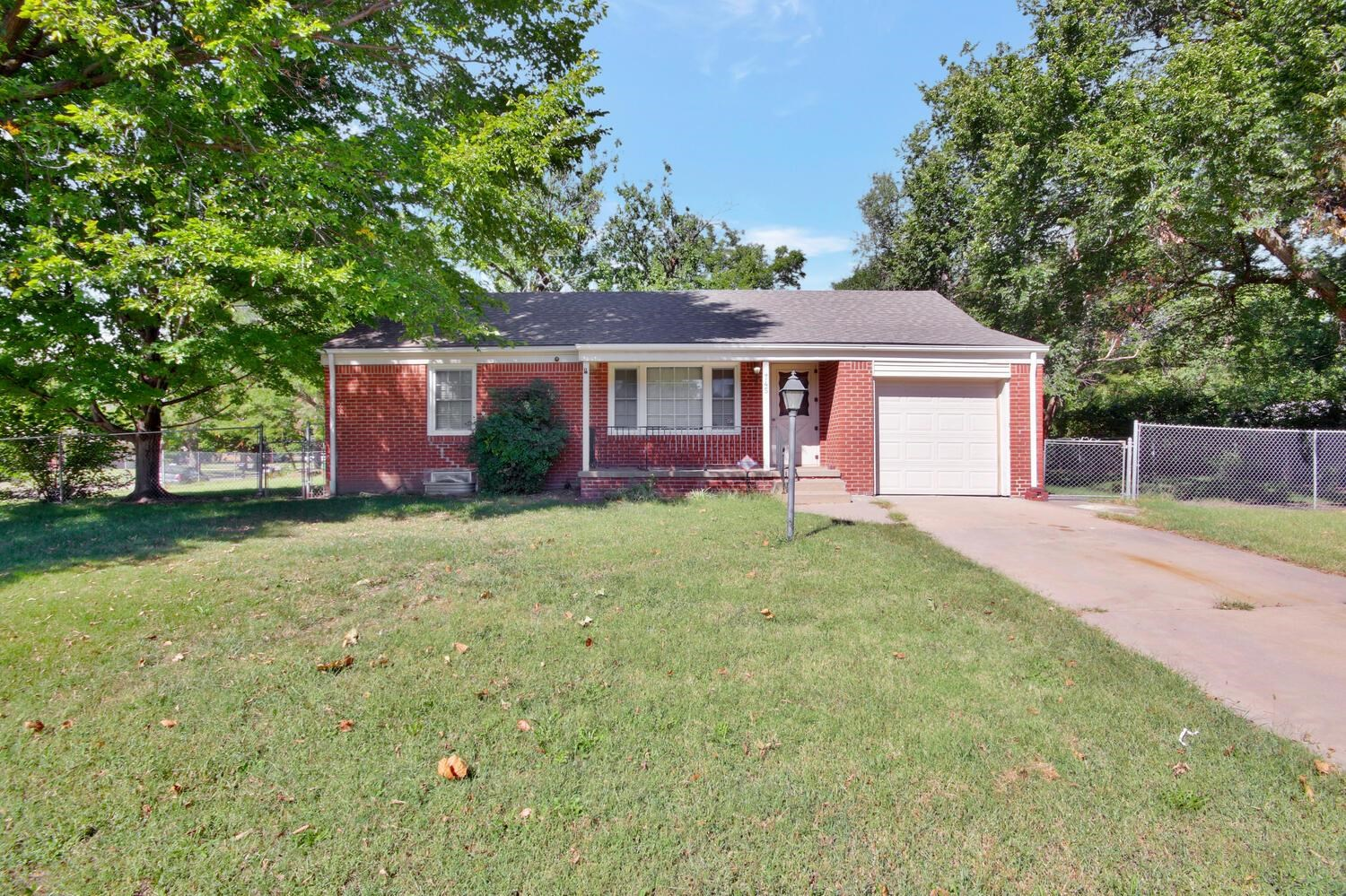 Your next home awaits! This lovely home is located on a HUGE CORNER LOT offering a great opportunity
