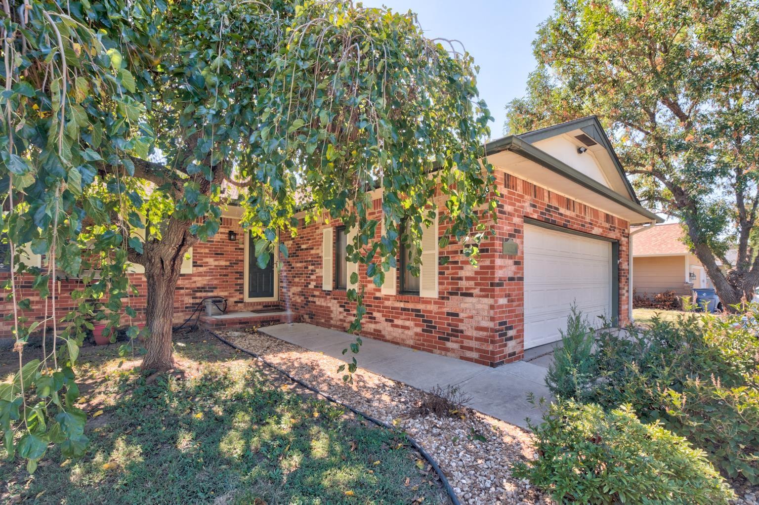 Welcome to this charming corner lot ranch home in a quiet and established neighborhood. Lovely main