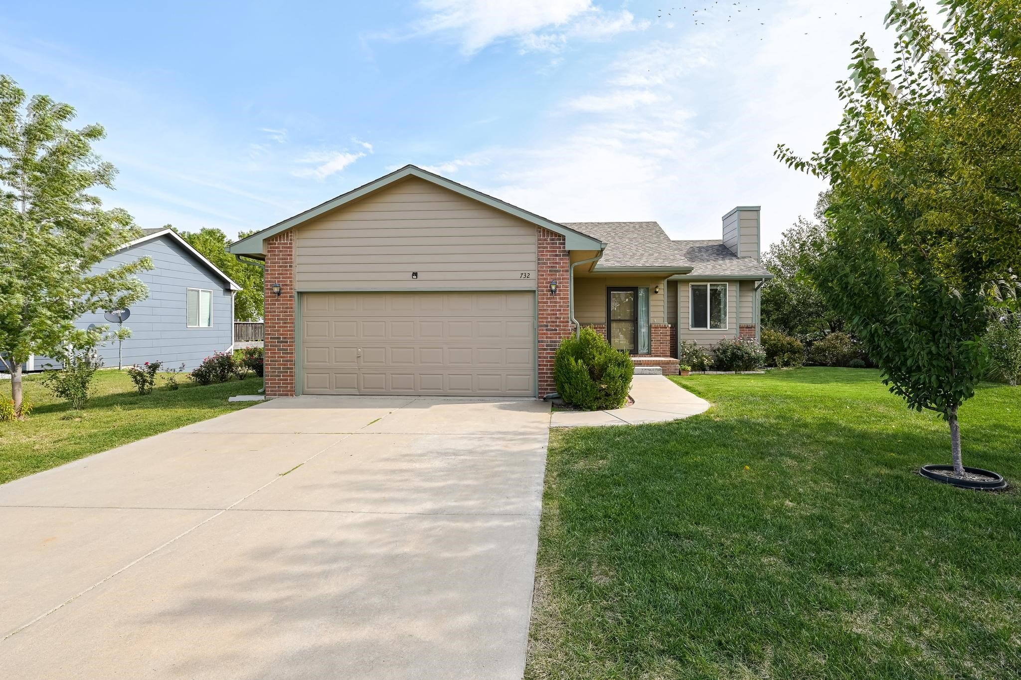 Move in ready home in the Maize School District! Beautiful landscaping and the freshly painted exter