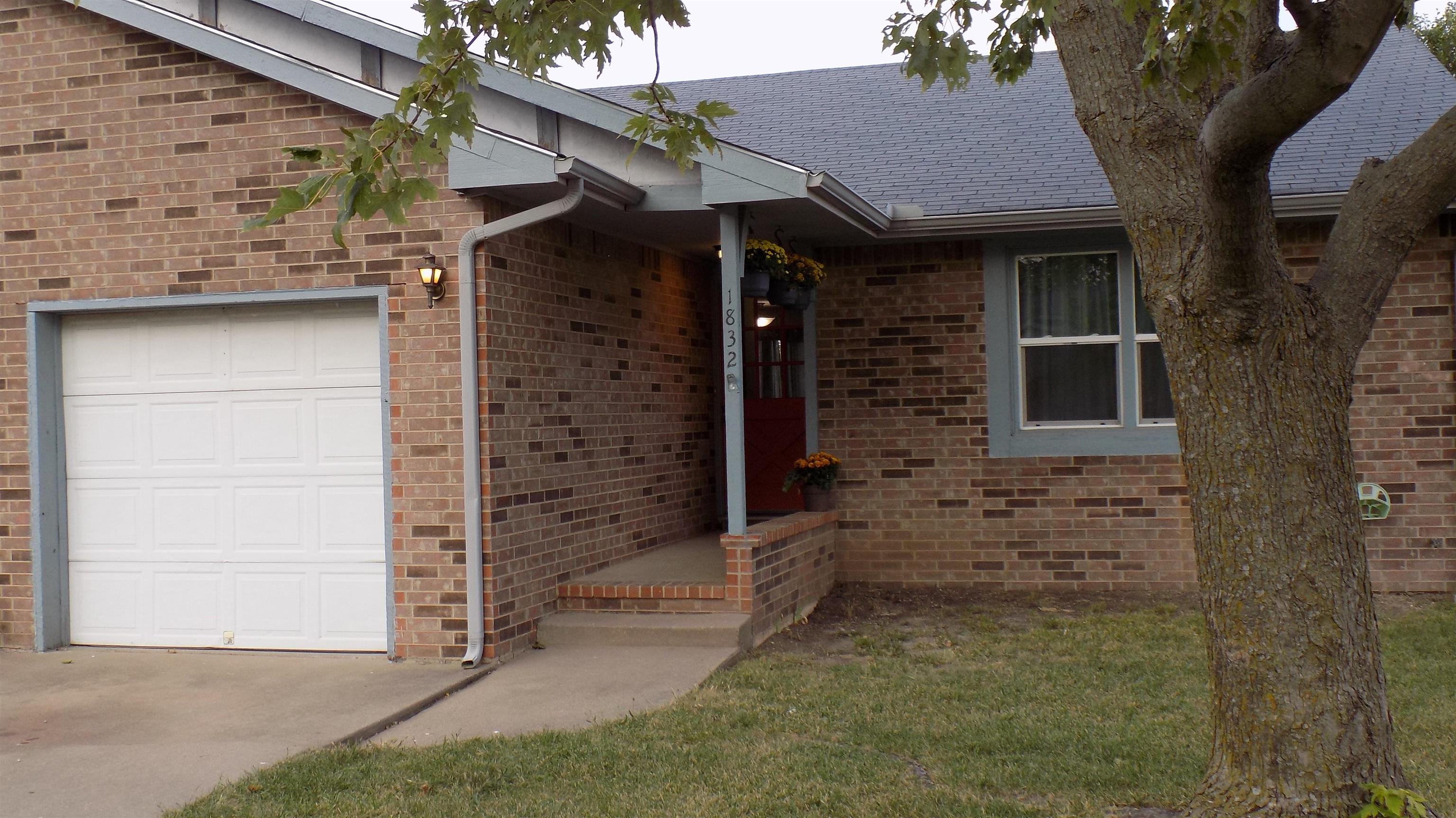 Newly renovated twin home with fresh paint, new appliances and carpet, and new flooring, renovated b