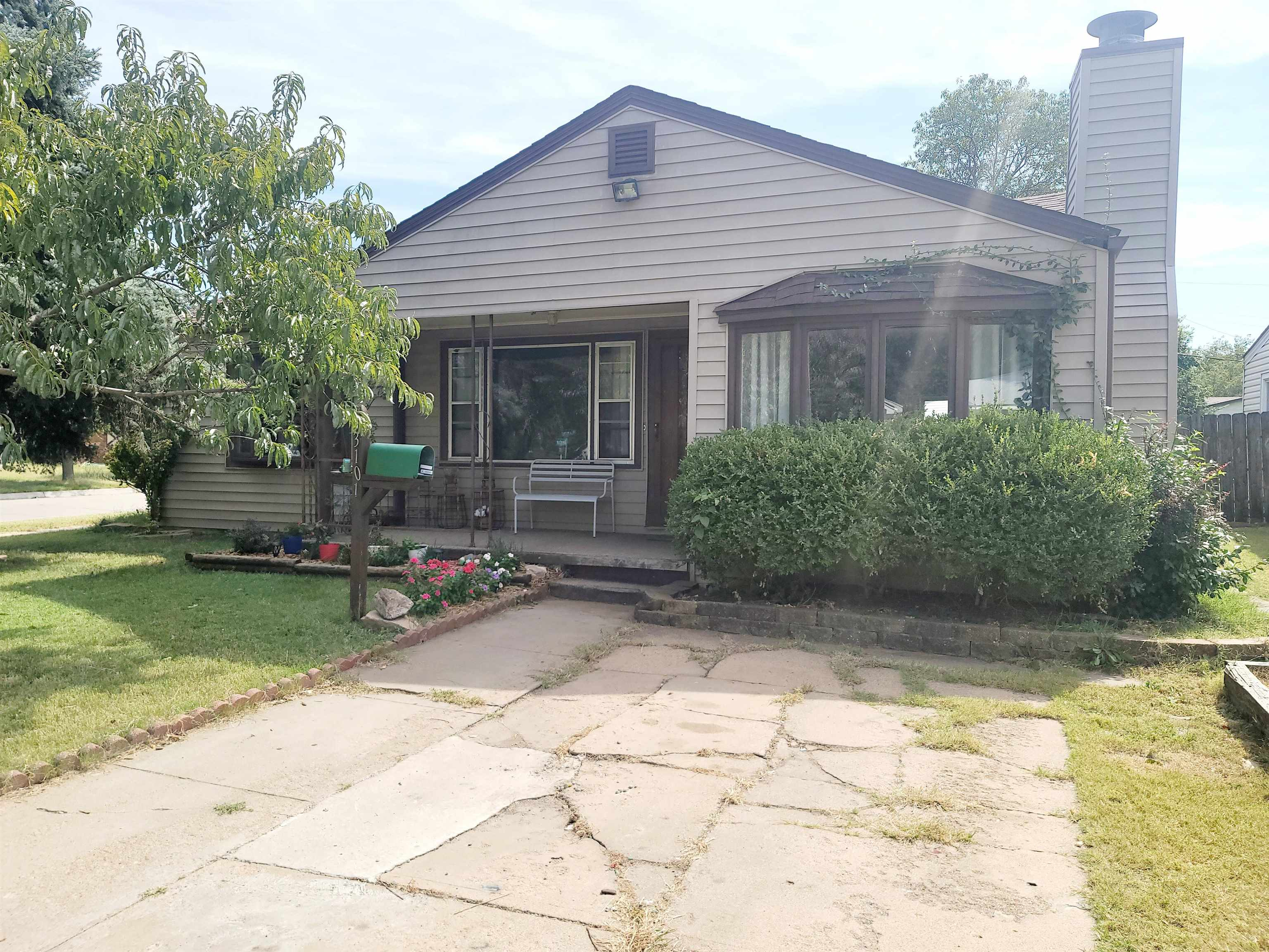 Must see this charming corner home in a quiet neighborhood. Livingroom has a large picture window pr
