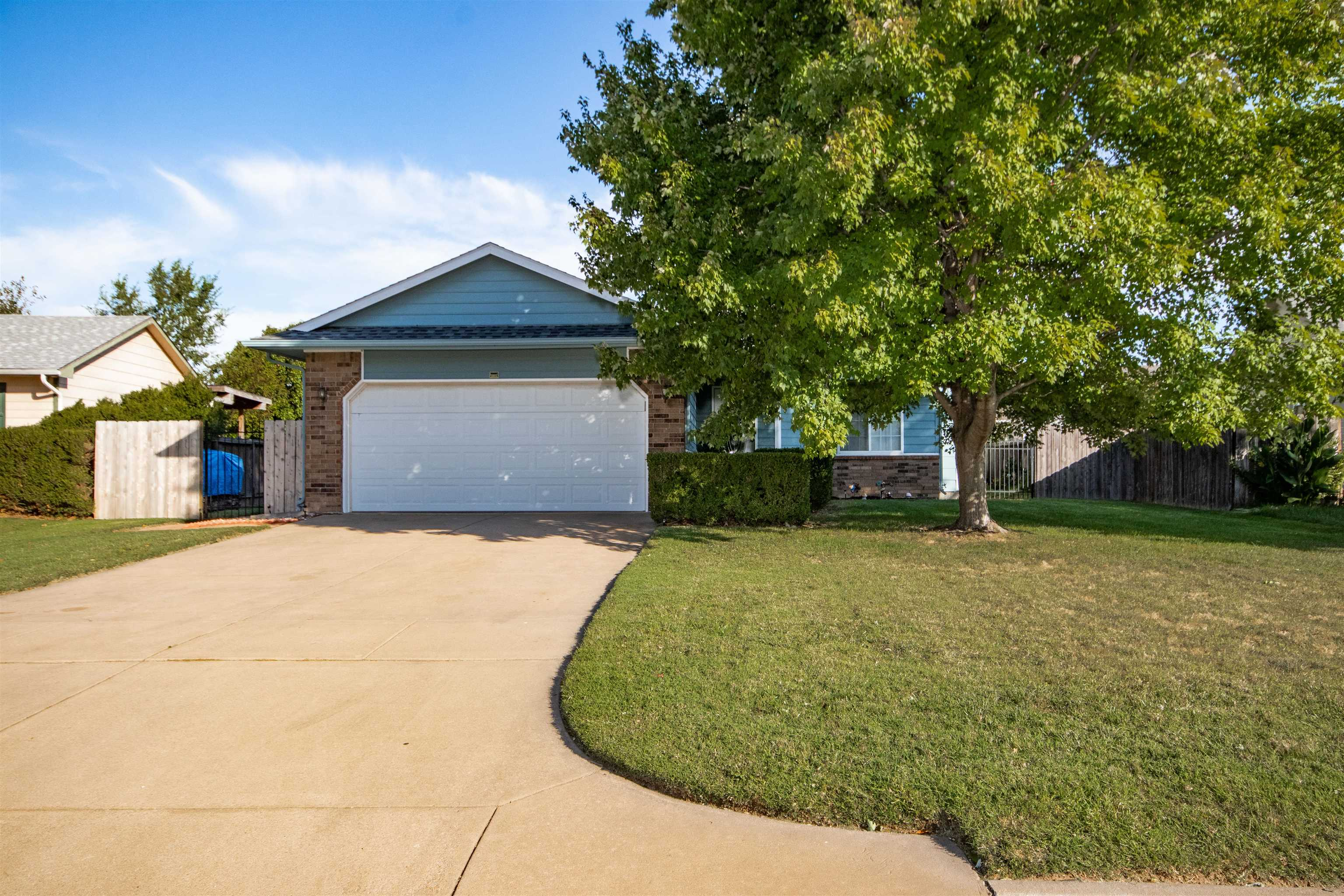 Don't wait to see this great home in south Wichita. Great curb appeal on this nearly quarter acre lo