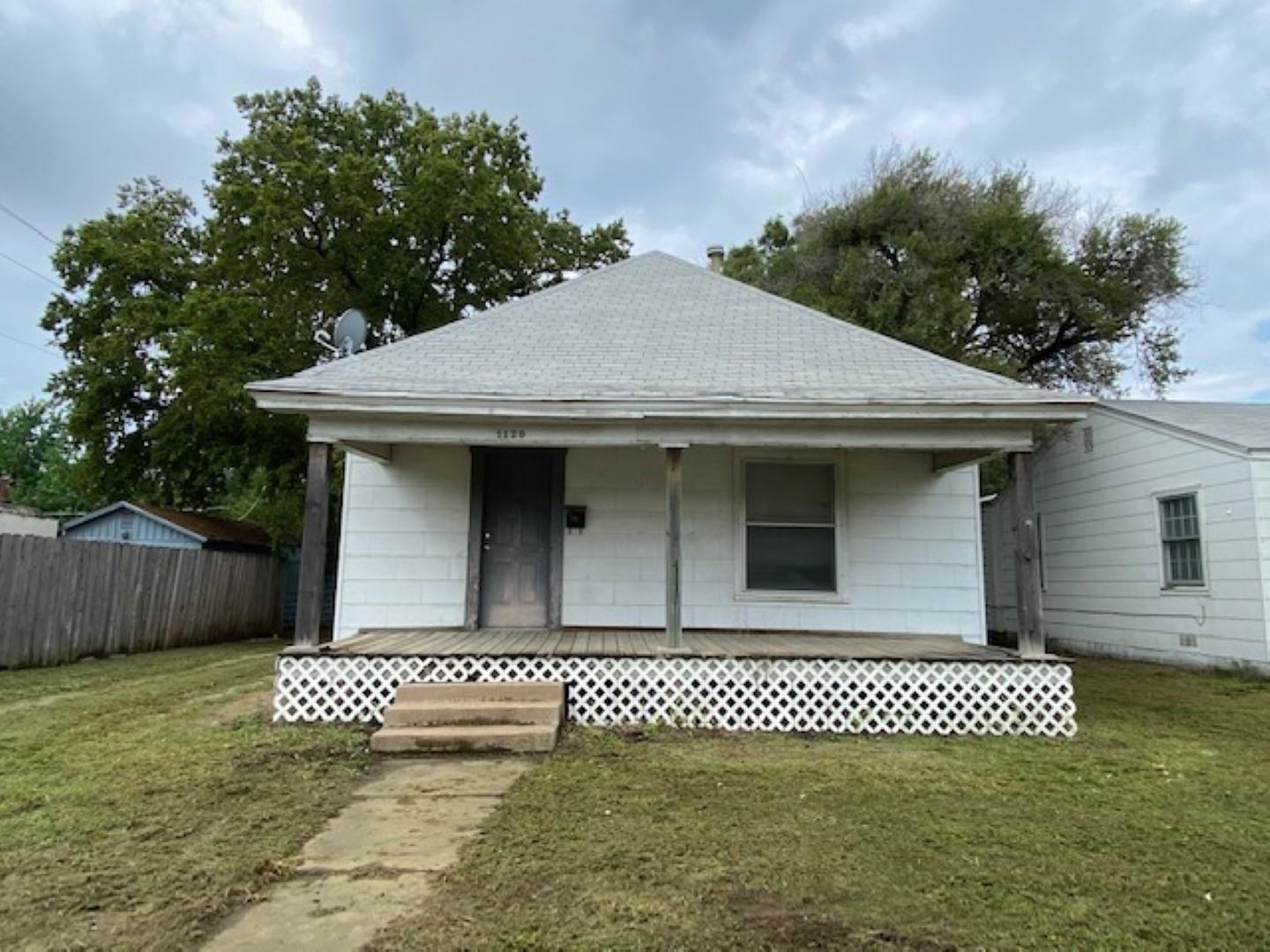 Fixer upper with great potential. Can be purchased alone or as a package along with 1121 S Seneca, 1