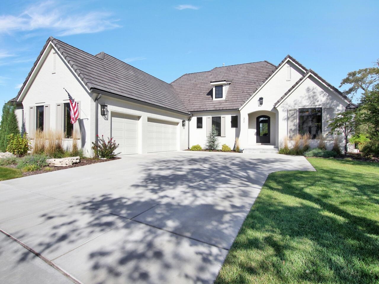 This spectacular, nearly new Nies built home is located on a quiet cul-de-sac in scenic Flint Hills