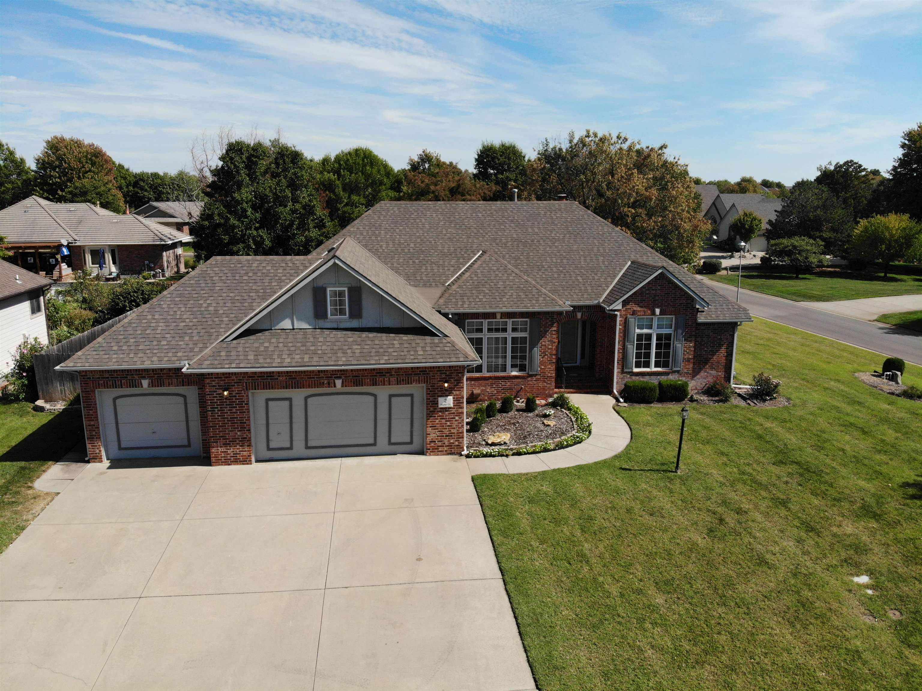 Big dreams fulfilled here! This spacious and accommodating all-brick custom ranch in Knebler Additio
