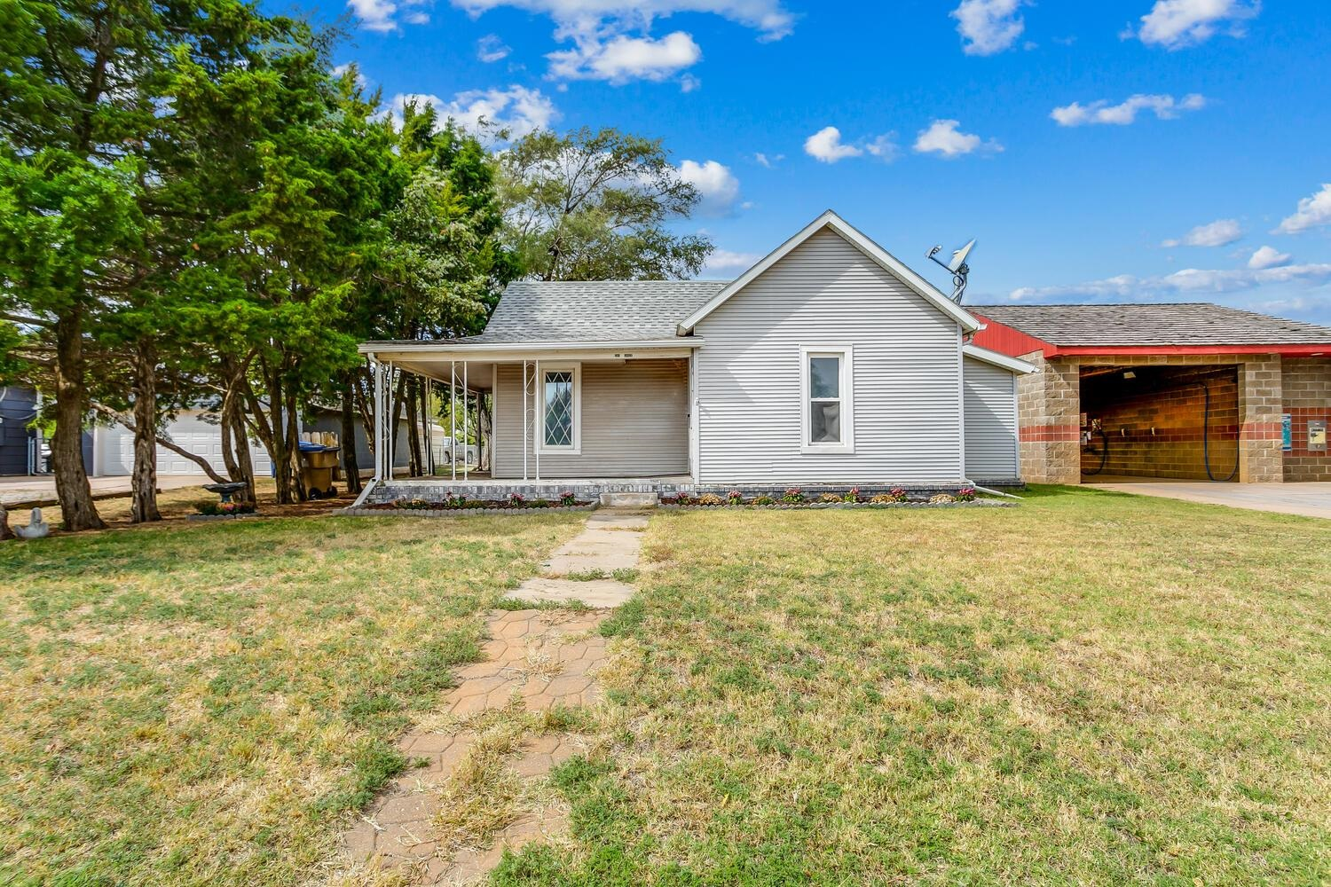 """Great starter home or investment property!  This two-bedroom one bath home has so much potential!  Enjoy the backyard oasis with a storage shed, fire pit, alley access, and plenty of shade.  Come love small town living!  This home is being sold offered in """"As Is present condition"""" seller to make no repairs."""