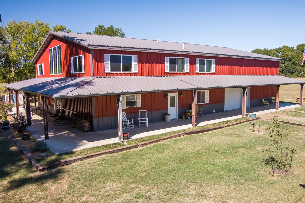 Nestled at mouth of the Walnut and Arkansas Rivers, this property is both peaceful and beautiful. This 2017 barndominium has 10-11 ft covered porches on three sides as well as a large sized cement pad for the 14 ft door in front of the barn. The house has 3300 sqft offering 5 bedrooms, 2 full bathrooms, 2 half bathrooms and an open floor plan that makes family functions a breeze. The kitchen is impressive with all the cabinets a cook could ask for, granite countertops, copper farmhouse sink, commercial stove with double ovens, and a beautiful island with a small copper sink. The dining and living rooms have cathedral ceilings showing wonderful woodwork as well as a wood burning stove. The master suite, located on the main floor, is great in size. A walk in closet is perfect with many shelves and hanging racks for all of your needs. The master bathroom is an oasis-featuring a clawfoot tub, separate shower, and double sinks. Finishing the main level includes a half bath, walk through laundry room, and walk in pantry.  Upstairs, the loft occupies 4 bedrooms, a full bathroom, and second living space.  The 50x40 barn includes a bar and bathroom- perfect for a man cave. A separate electric panel is wired to make for your specific needs.  Outside sits a waterfall koi pond to admire sunrises and sunsets. A chicken coop and storage container are both included with this beautiful property.  Finish the day by walking to the river, for you will not be disappointed!  Schedule your private showing NOW for this stunning property!