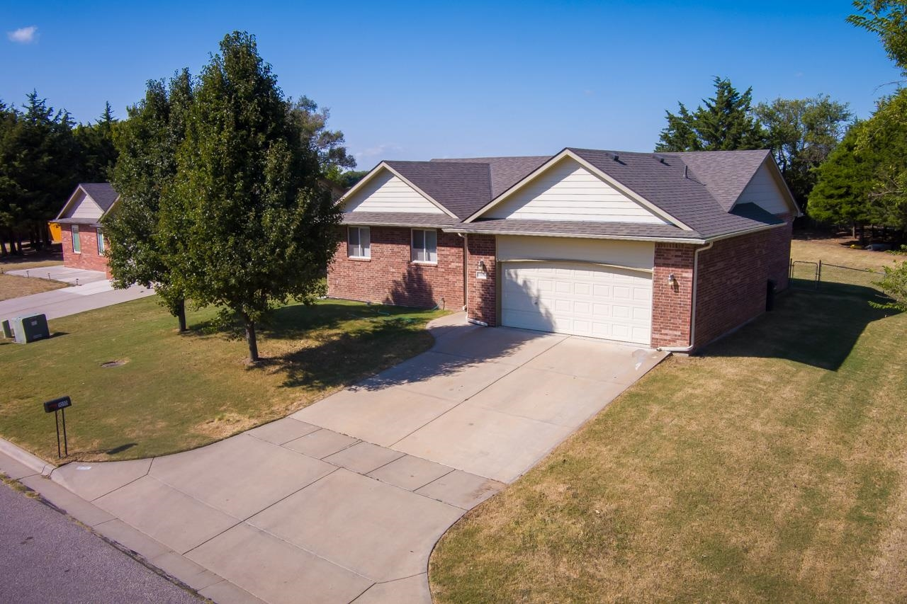 Very tastefully updated all brick ranch with high end finishes in an excellent location in the Forrest Glenn subdivision! As you arrive you will love the quiet neighborhood and appeal of this quiet and peaceful location! Inside you will find vaulted ceilings, all new laminate in the living spaces, all new carpet in the bedrooms, new trim, doors, fixtures and more! The vaulted living room is spacious and open to the dining room offering a semi open concept your looking for without having your kitchen exposed 24/7! As you head into the kitchen you will be thrilled to find high end updates such as granite, BRAND NEW black stainless steel appliances, pantry, and island! The split floor plan is another great feature and the master suite offers full bathroom complete with separate soaker tub/walk in shower and large walk in closet. Additionally on the main level you will find two additional bedrooms and full hall bathroom! Need more space? No worries the newly remodeled basement offers an excellent family room, rec room and large 4th bedroom! The basement bathroom is roughed in and could easily be turned into your third full bathroom! With an attached two car garage, large backyard this is the home you have been waiting on! Do not delay call the listing agent today to schedule your private tour!   *All trim work/touch ups to be completed prior to closing!