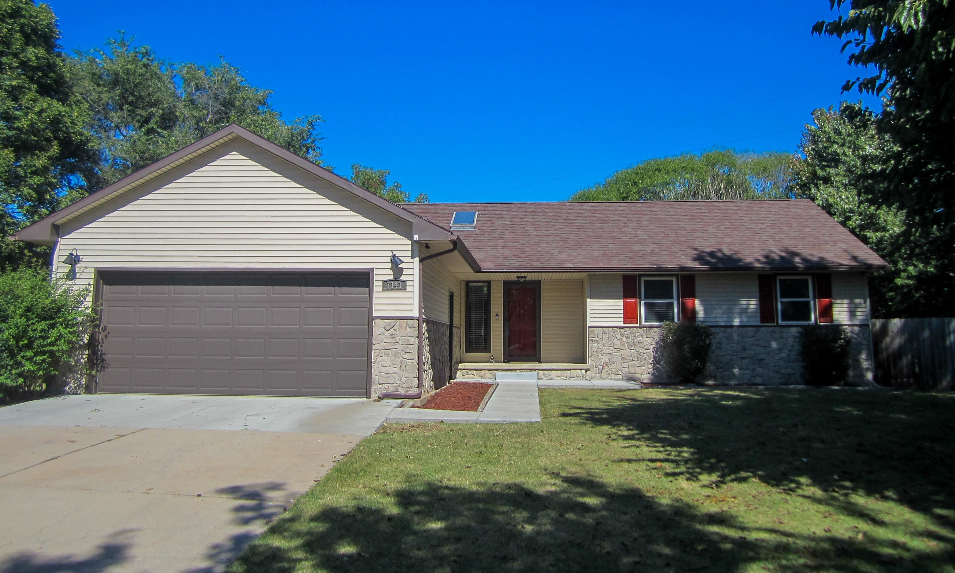 Very cool ranch style home situated on a 1.03 acre lot in northeast Wichita! Move in ready with a ne