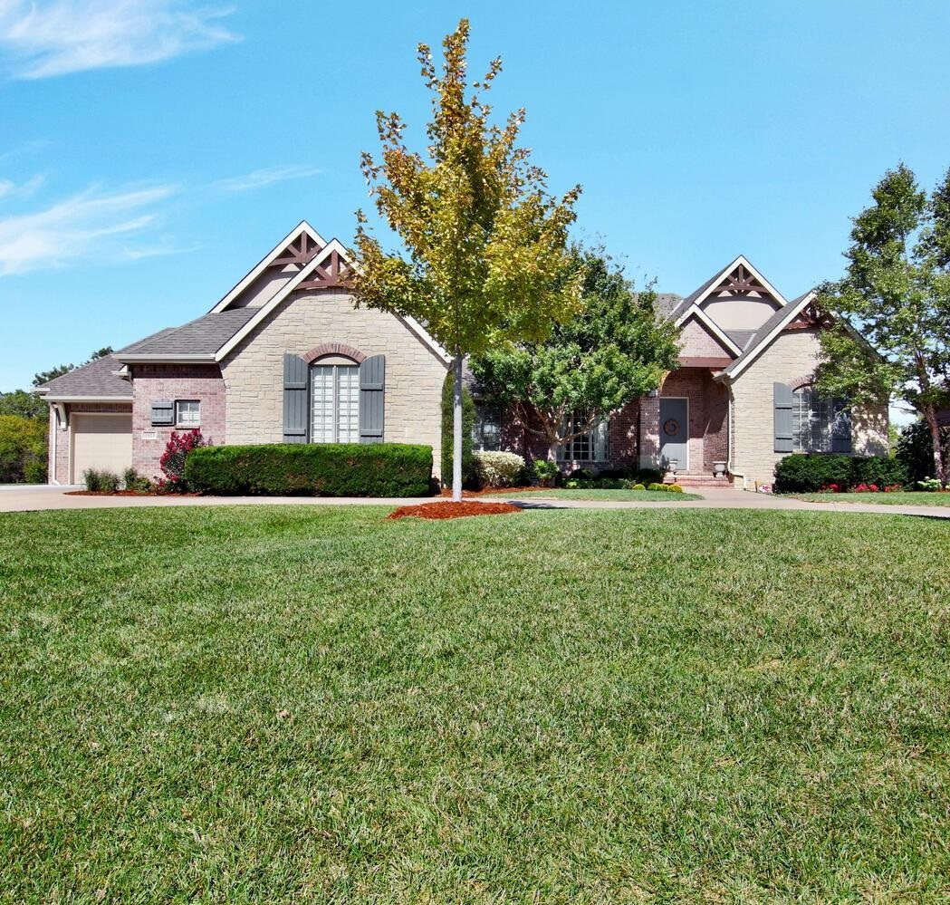 This is it; perfectly situated on a cul-de-sac lot backing to a dense tree row in desirable Garden W