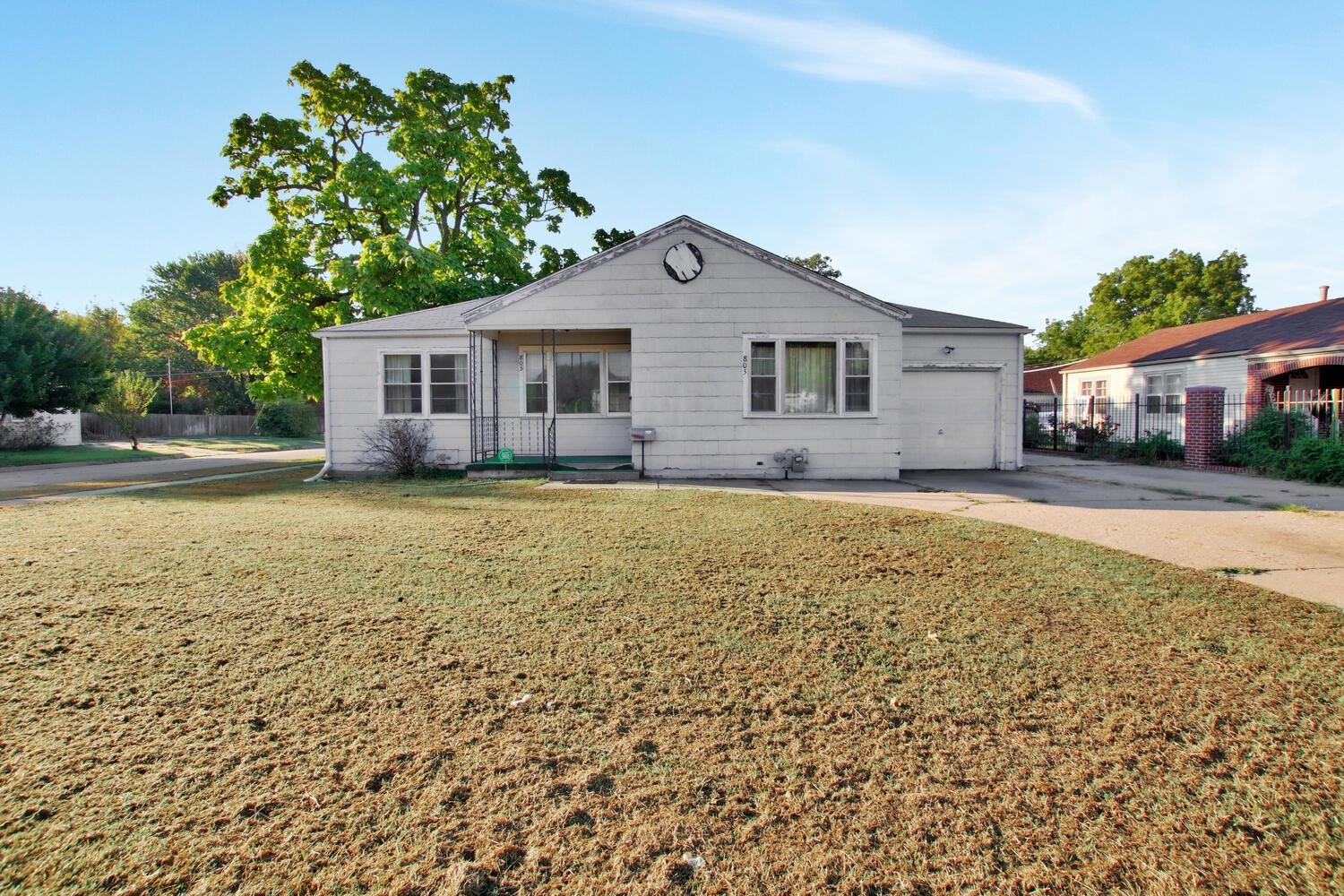 Are you looking for a huge lot (Almost half an acre!) and a man-cave or she-shed? Here it is! With a little TLC and paint this 3 bed, 1 bath house can be made into a perfect home on a huge lot! The house has a one car attached garage and a HUGE detached garage (30' x 40') with 3 doors but could fit many more.The garage is insulated, has a heater and 220 wiring.Chain link fence around the entire back yard. Nice patio to entertain or enjoy evening barbecues.