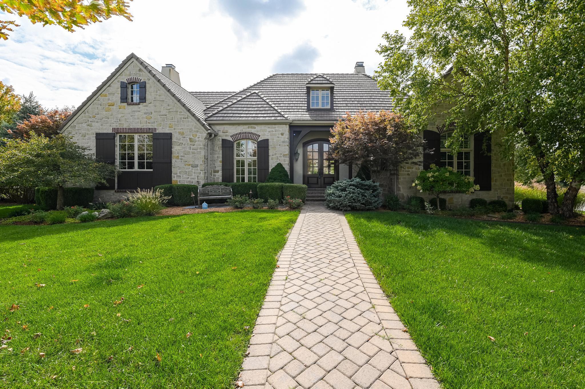 A custom VanBuskirk built partial stone ranch patio home. 4 bedrooms, walk-in closets, 4 ensuite bat
