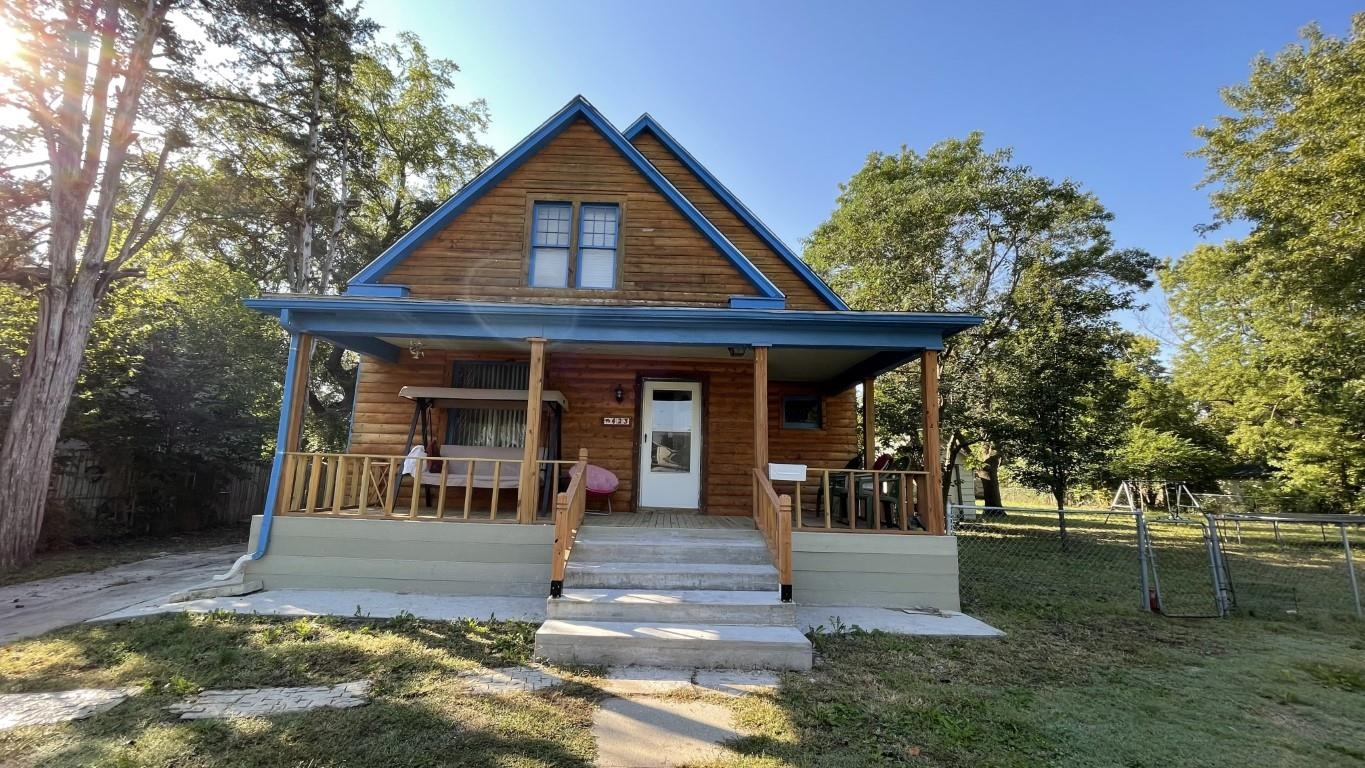This is a lovely log cabin style older home. Only one room has carpet the rest of the house has wood/tile floors. The cellar is located in the utility room next to the kitchen. The seller recently updated the front porch which gives the home a more cozy feel. The house sits on a half acre lot. Huge fenced in back yard perfect for any use.
