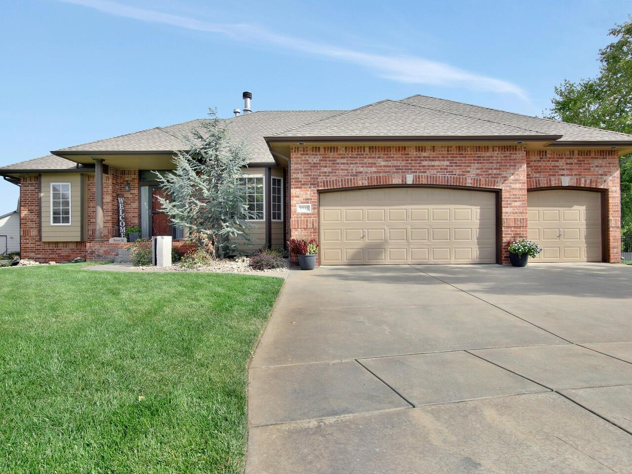 Located in Desirable, In-Demand Ridge Port Addition!  This Ranch Home is Move-In Ready.  Freshly painted, Hdwd Flrs, & 10ft Ceilings.  Spacious Living Room featuring corner FP.  Gas Log FP is 2-way shared with the Frml Dining (which could also be a great den, office or music room).  Kitchen offers a Walk-In Pantry, Stainless Steel Appliances, Tile Topped Eating Bar.  Split Bdrm Plan.  Master Suite is Nice-Sized with Vaulted Ceiling, Bay Window, Walk-In Closet, Mstr Bath, & Private Covered Balcony.  Mid-Level WO has Huge Rec/Game Room with New wood laminate flrs, Wet Bar & Brick WBFP with insert & blower.  Bedroom #4 with Hollywood bath has walk-in closet off the bath.  Additional bonus room or office in the Bsmt.  Extras Include: Concrete Safe Room, Full-Length Patio New in 2020, High Efficiency HVAC New - 2019, New Roof & Gutters - late October 2021.  Fully Insulated 3-car Garage with Nice Built-in Cabinets & Garage Door Opener New - 2020.  Huge 1/3 Acre Lot.  No Specials!!!  Ridge Port features a 45 acre Boating & Fishing Lake with Beach Area & Pool and is located in Sought-After Maize South Schools.