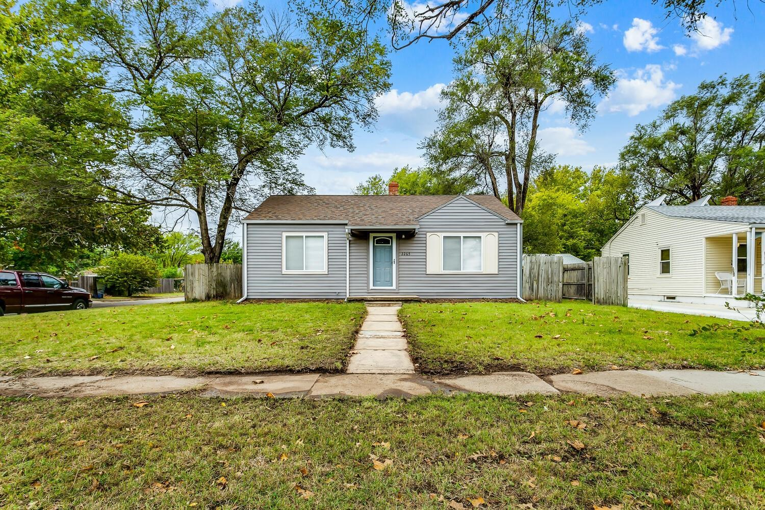 Come home to this newly remodeled, quaint home in southwest Wichita. This home on a corner lot has b
