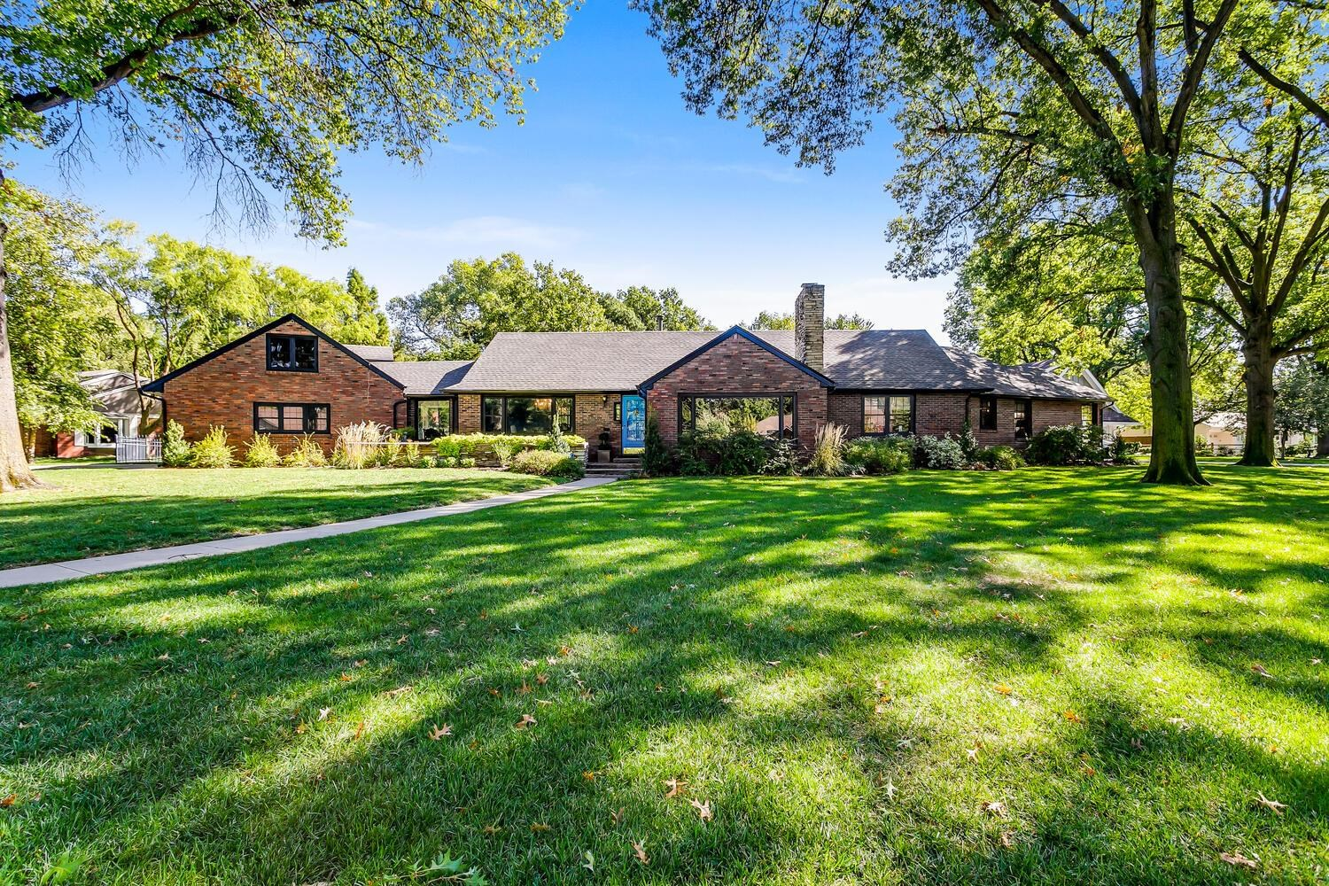 This 4 bedroom, 3.5 bath sprawling ranch home has been carefully remodeled to retain the charm and c