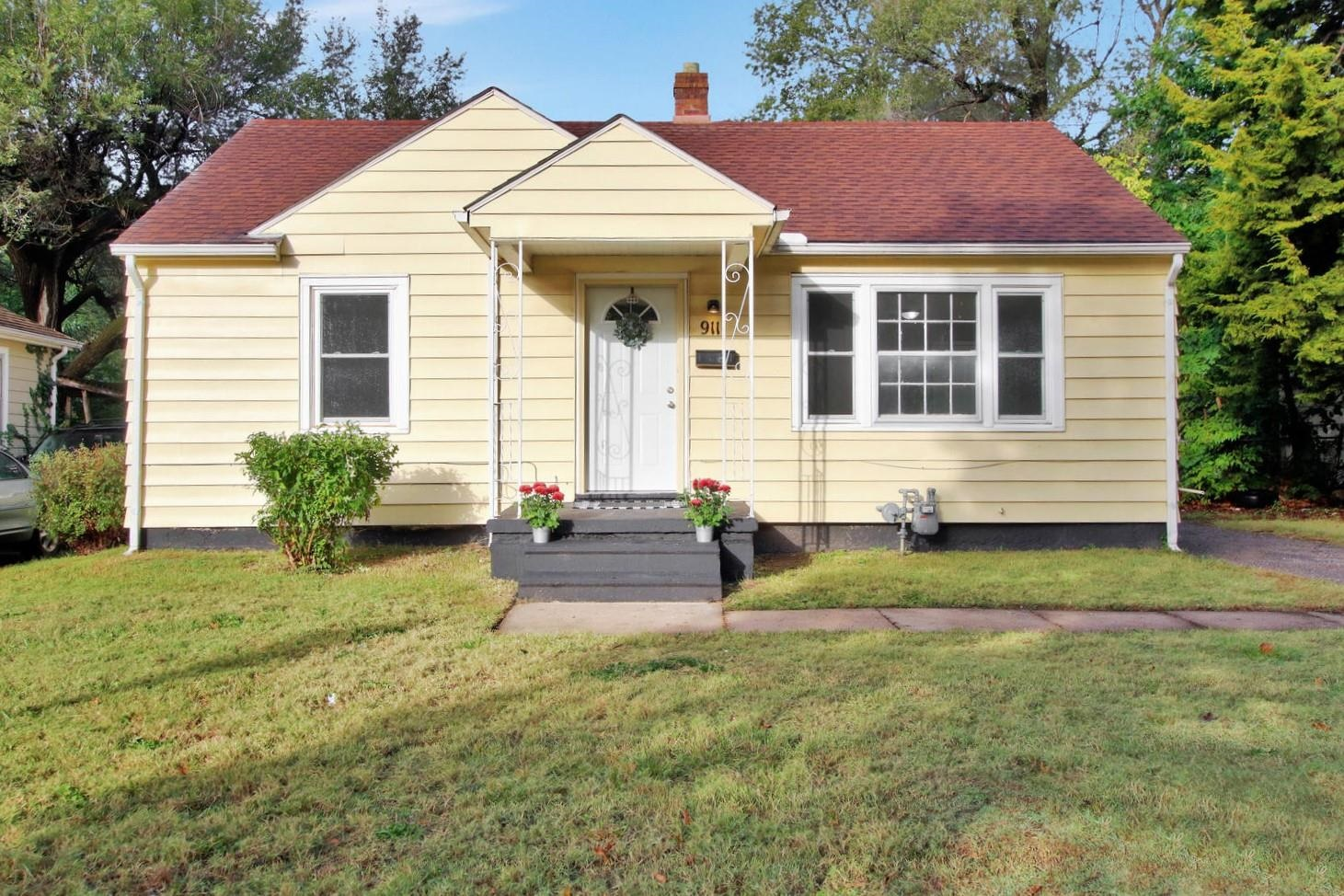 Adorable & fully updated northeast Wichita home. Exterior features vinyl siding, a covered front por