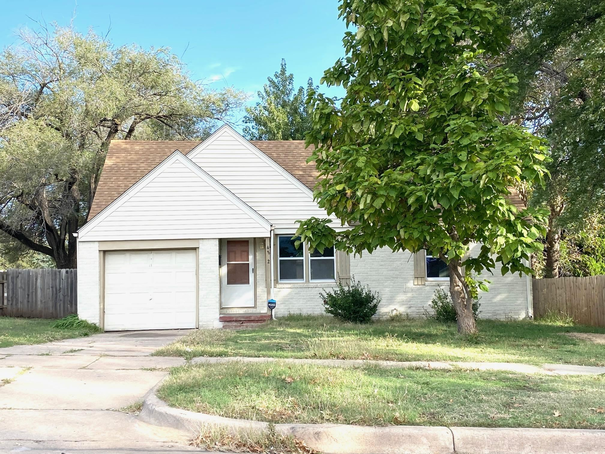 Check out this great investment opportunity:   3 bed, 1 bath with the attached garage.  The home has