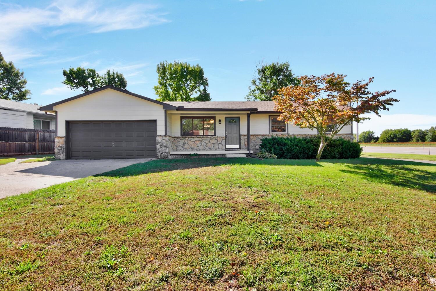 Great Ranch Home with new siding, exterior paint, and new concrete patio in the backyard.  Newer win