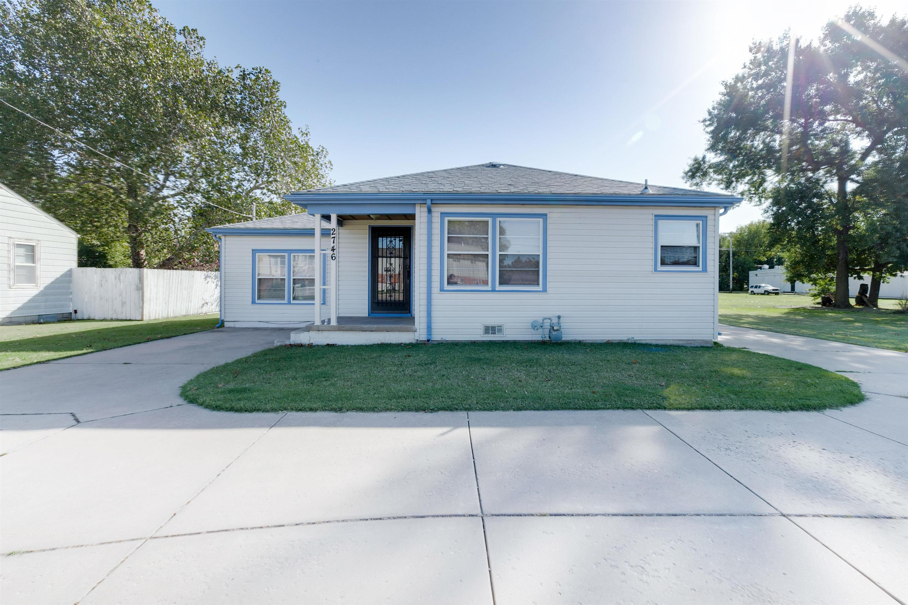 Cute and Clean Three Bed, 1 Bath. Large detached 2 car garage with extra large backyard on 1/2 acre!