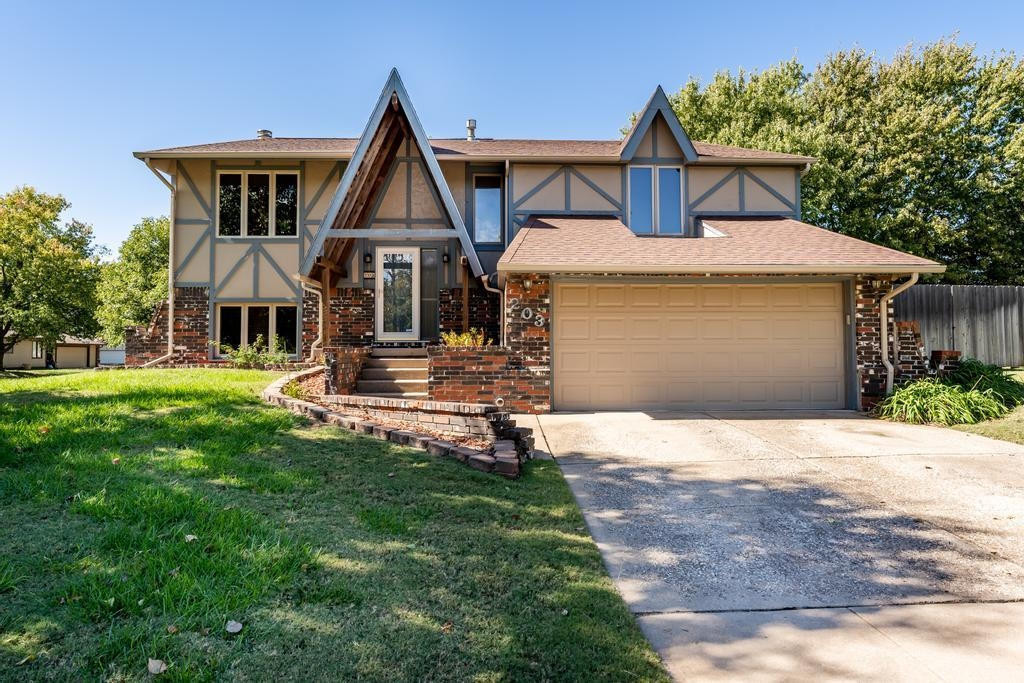 Nestled on a corner lot in a quiet cul de sac, this stunning west Wichita home offers plenty of wond