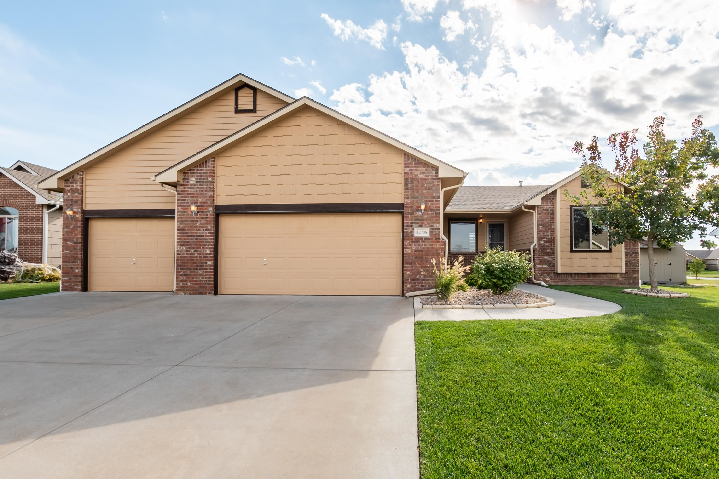 Move in ready home in Goddard school district! This home features 4 bedrooms, 3 baths and a 3 car ga