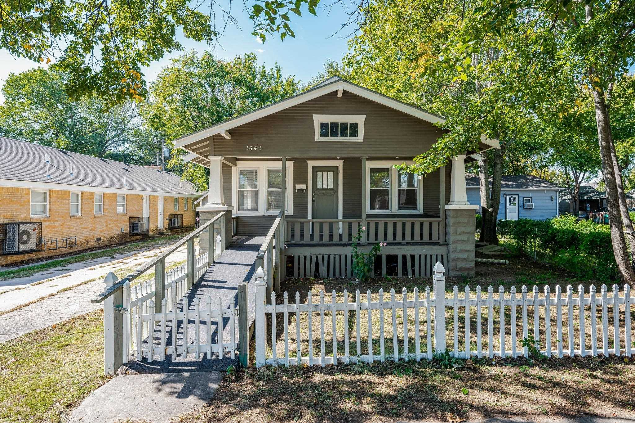 This home is a 2-bedroom, 1-bathroom home located in heart of Wichita. The exterior features a detac