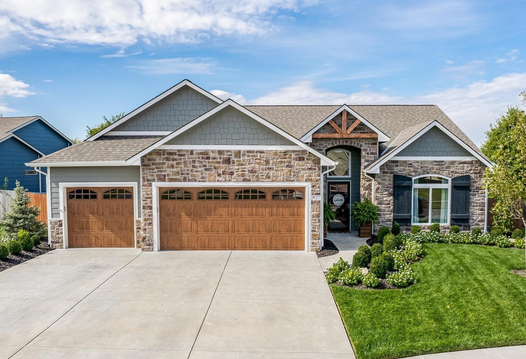 Welcome to this beautifully designed custom home in the Derby school district. This home includes 5