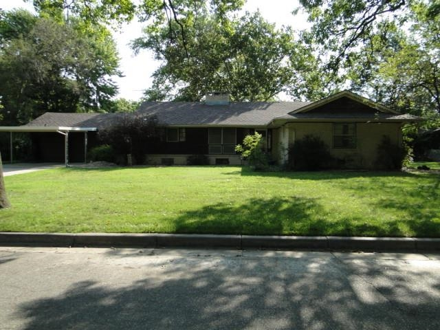This home is a classic 1950's ranch style house with a spacious yard and lots of mature trees, locat