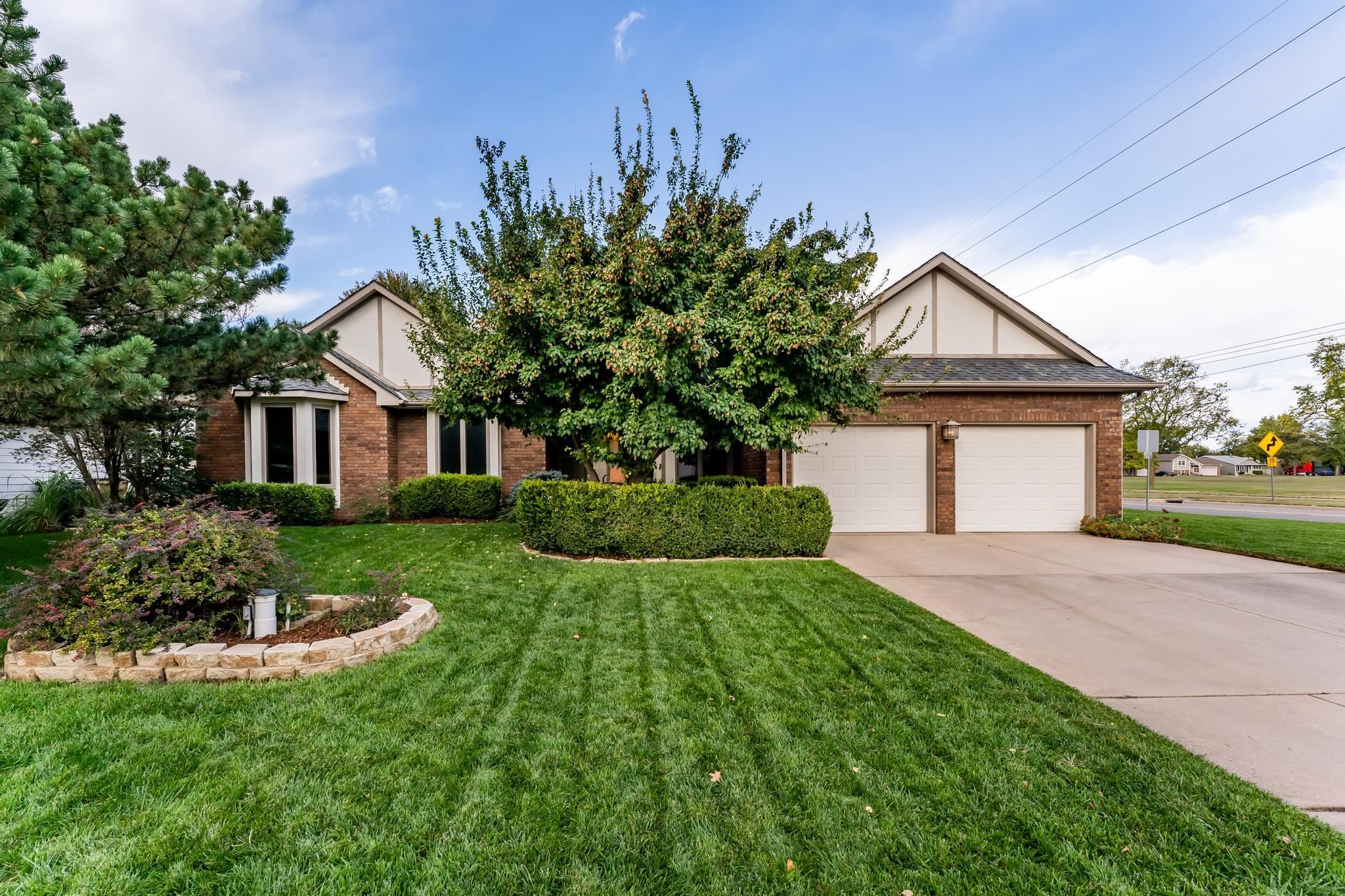 Looking for an impeccably well-maintained home in West Wichita? This is it! Admire the beautiful yar