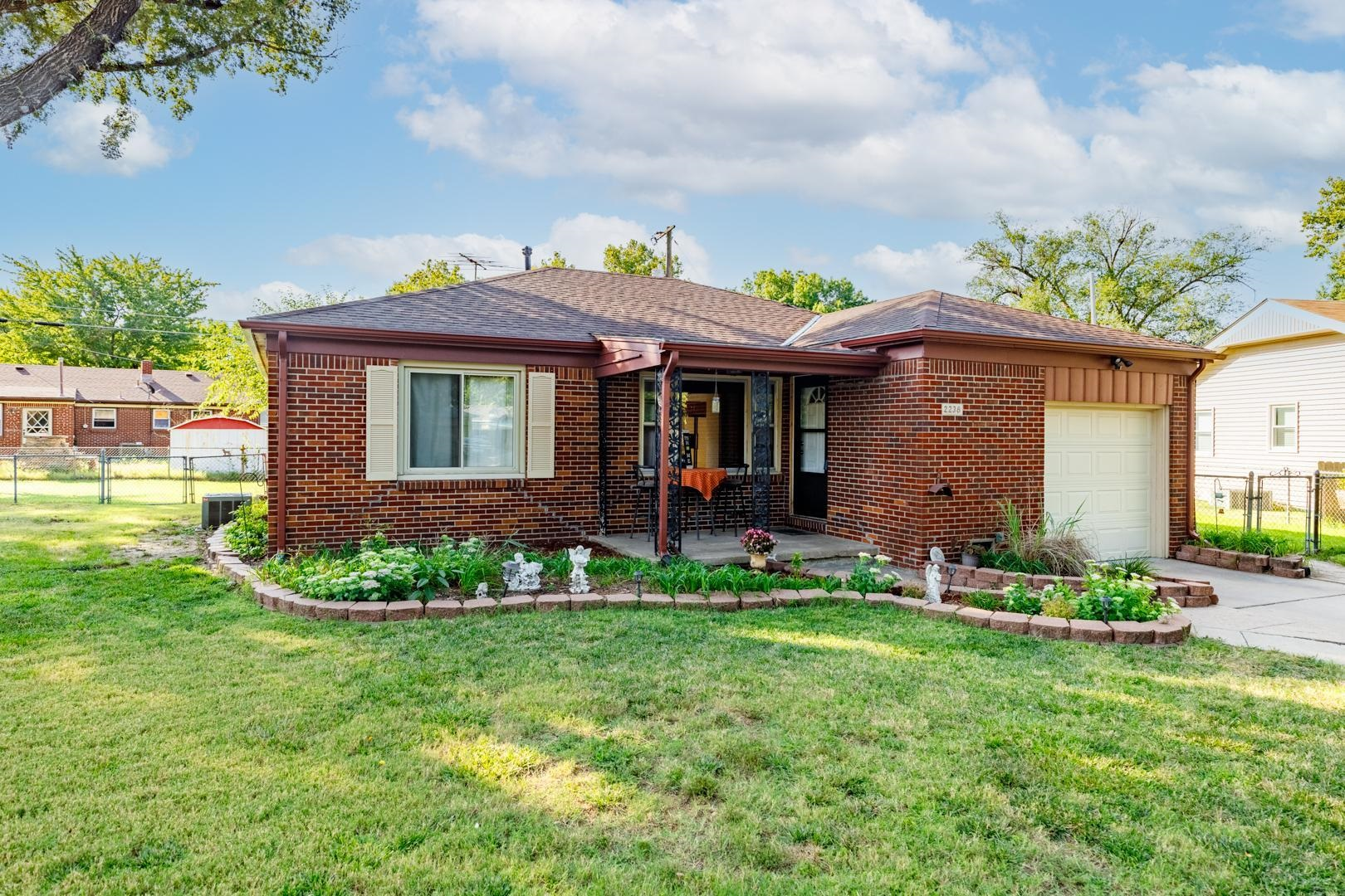 Welcome home to this charming move-in-ready 3bed/1bath/1car all brick home in SE Wichita.  Located o