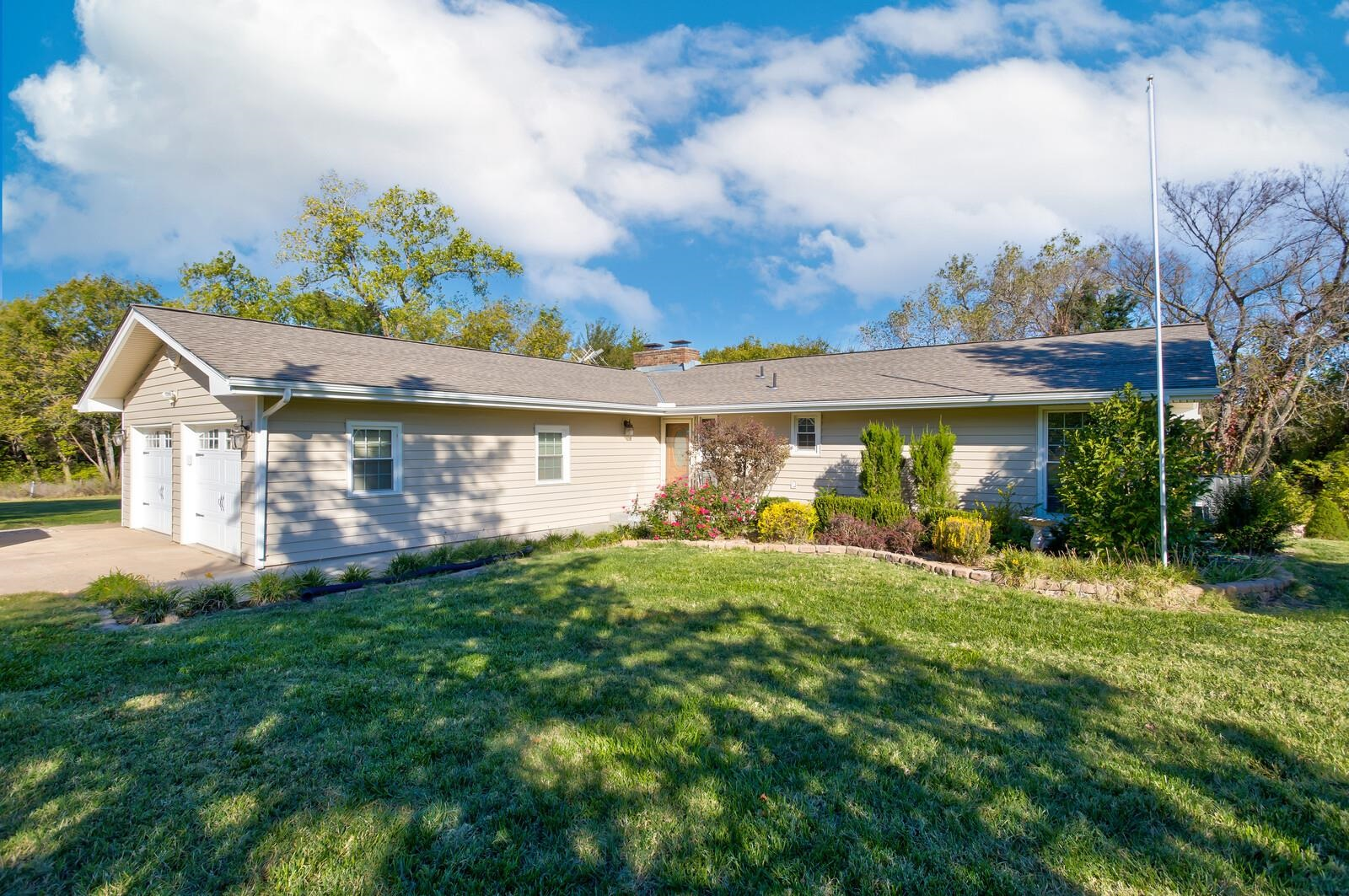 Great Ranch with Heavily wooded Creek Lot with a Pond on 10 acres. Updated Kitchen and remodeled Mas