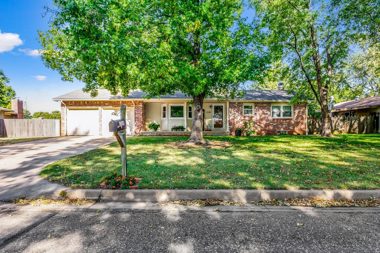 Darling home with great curb appeal located in a quiet neighborhood. Welcome to this three bedroom,