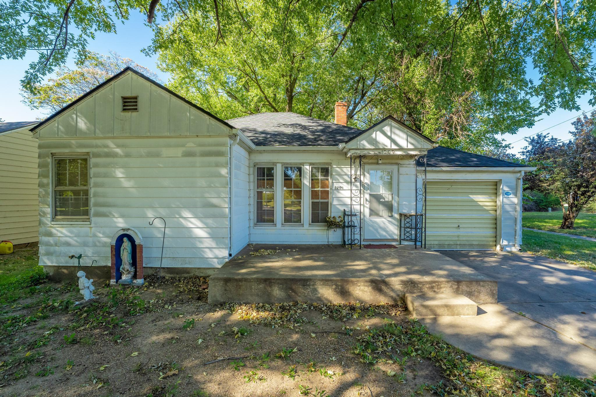 Great first time home or terrific investment property!  As you pull up to this home you see that it