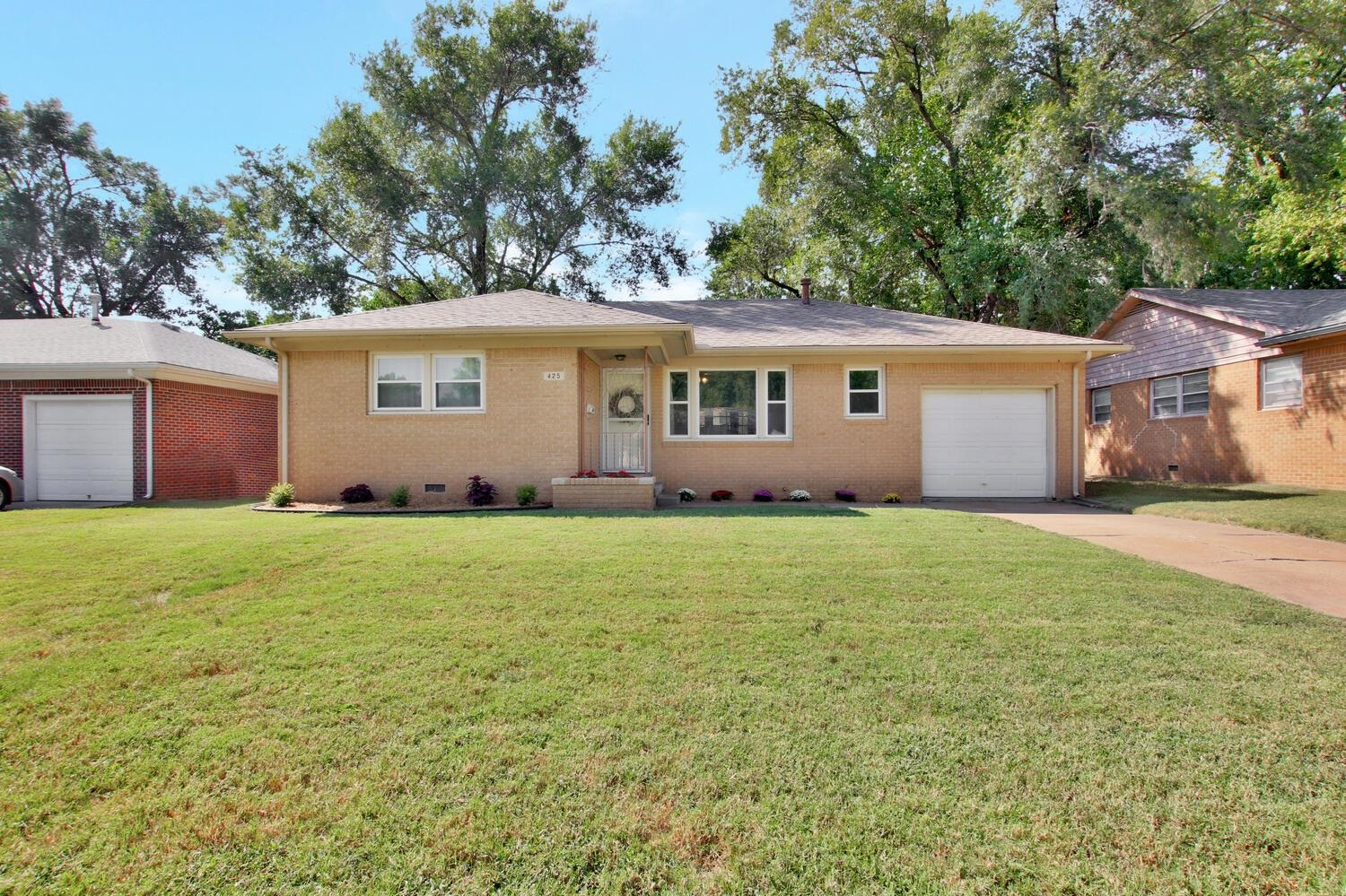 Darling 3 BR, 1 BA brick charmer is updated throughout and move-in ready! Enjoy hardwood flooring, w