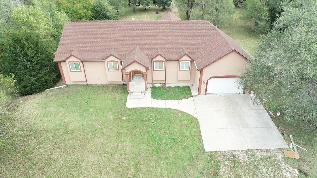 Wow what a home, room to stretch out and relax.  Minutes from Maize, with land to spare.  4 bedroom