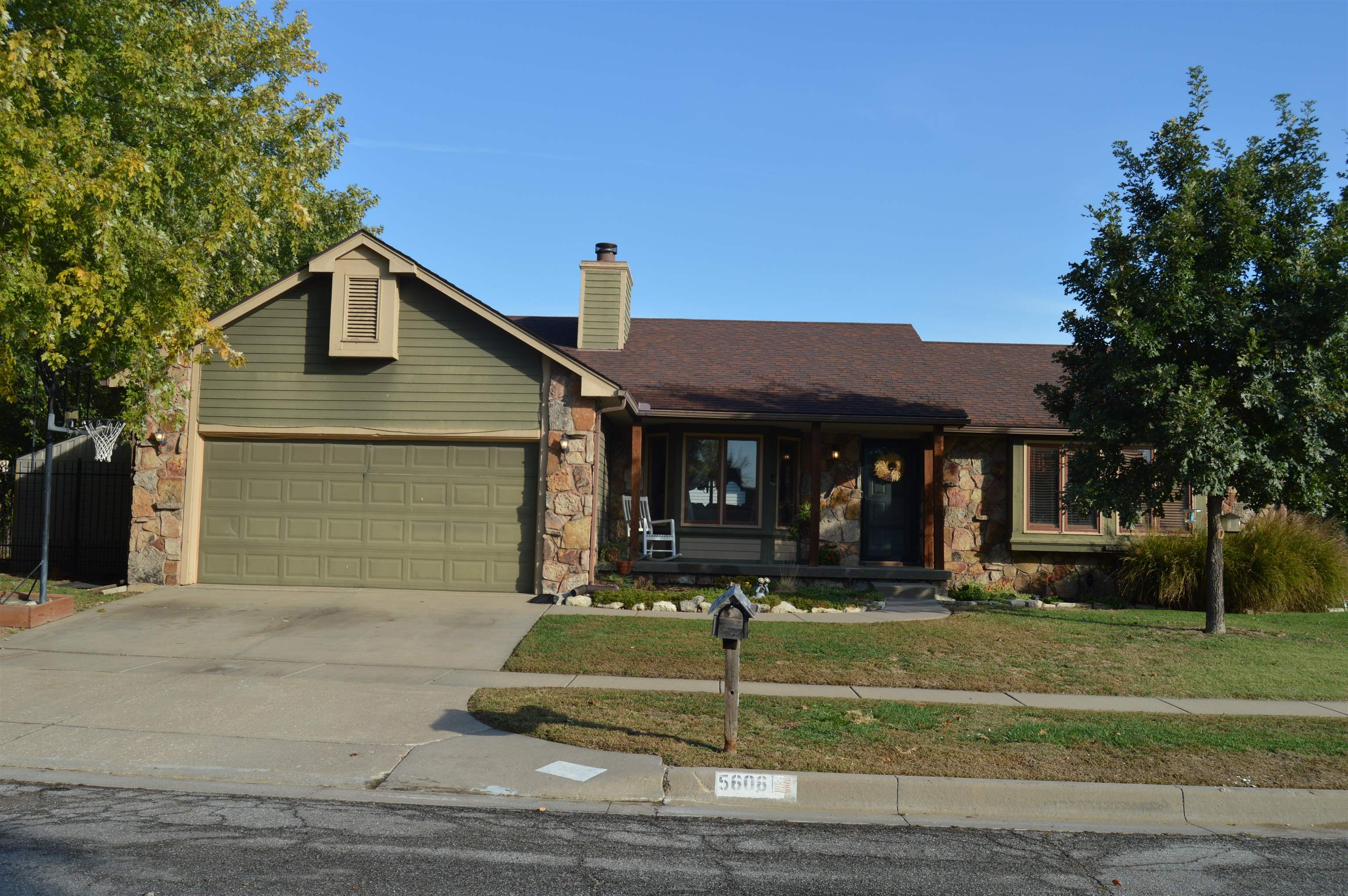 Welcome home to Bel Aire, this 4 bedroom 3 bath home is located on a corner lot with a wrought iron