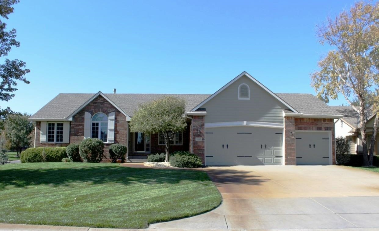 Meticulously cared for Ranch home on a corner lot with a lake view in the Maize School district. Tal