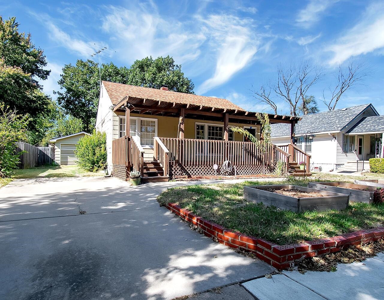 Fantastic North Riverside home for sale.  Featuring a huge front deck, beautiful hardwood floors, ba