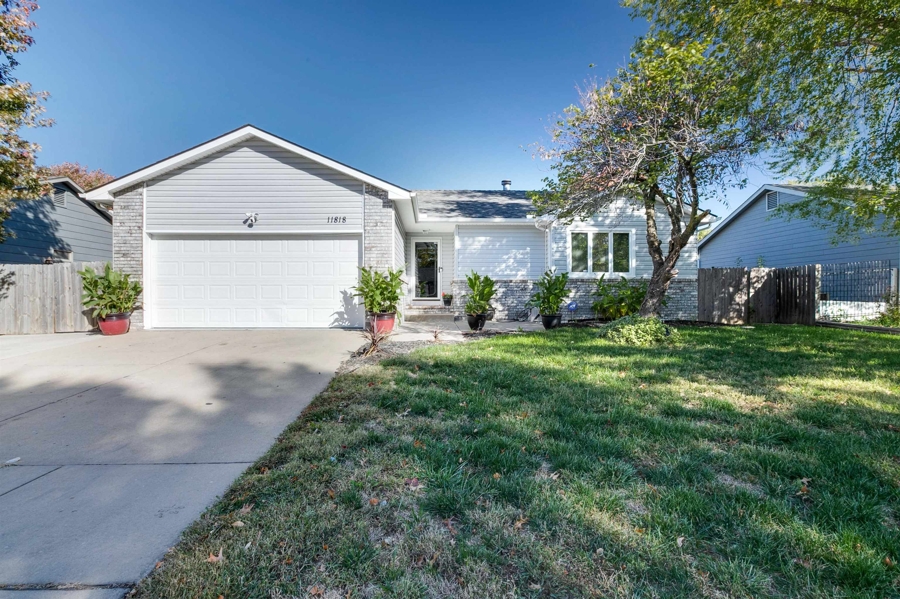 This west Wichita home has been beautifully maintained! The inviting living room with vaulted ceilin