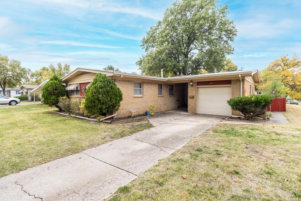 Welcome home to this charming 3 bed/1.5 bath/1 car all-brick ranch in the flourishing city of Derby.