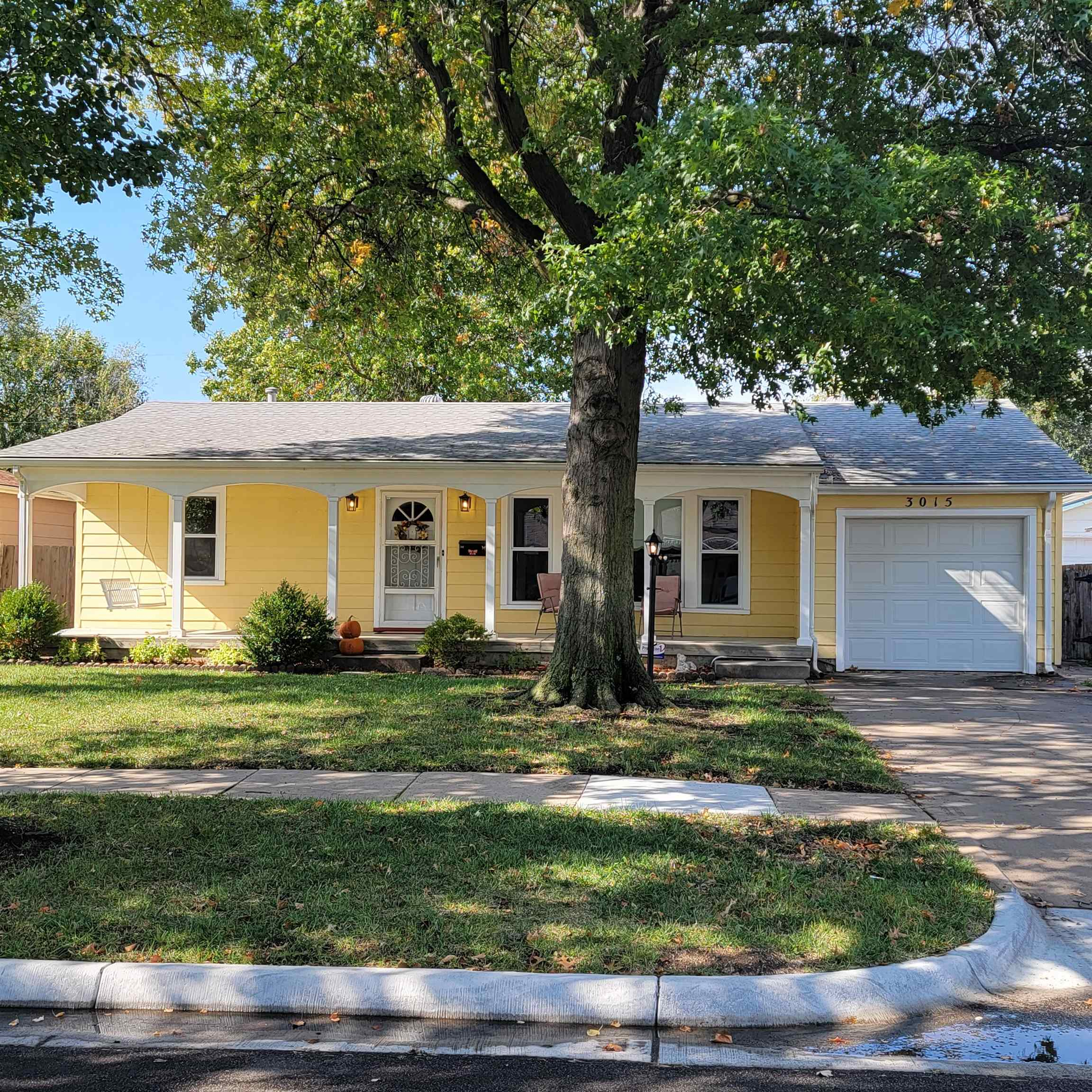3 bedroom large ranch style home with a large covered porches front and back. The Livingroom and Fam
