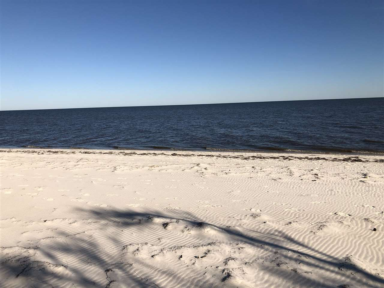 Lot dimensions are estimated.  Must be verified.   1.137 acres. Silence is golden.  All that could be heard the day of photos was the water lapping the sand.  Any view of the Gulf of Mexico is wonderful, but this is breathtaking.  White beach fronts buildable lot.  Backs up to Bald Point Stated Park.  Walking and biking trails.  The only footprints on the beach were mine. Nicely elevated.  Perfect for shelling and wading.  It's perfect no matter what the season.