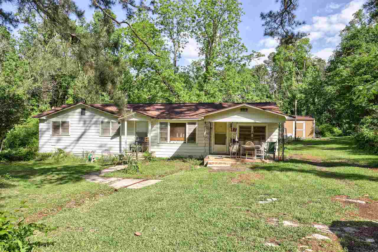 "Spacious Home just outside City Limits on 1 Acre. New carpet, 2019 roof and small renovations. Lots of Flowering Plants; Peach tree, plumb tree, and a pecan tree.  Sold ""AS IS"" with right to inspection"