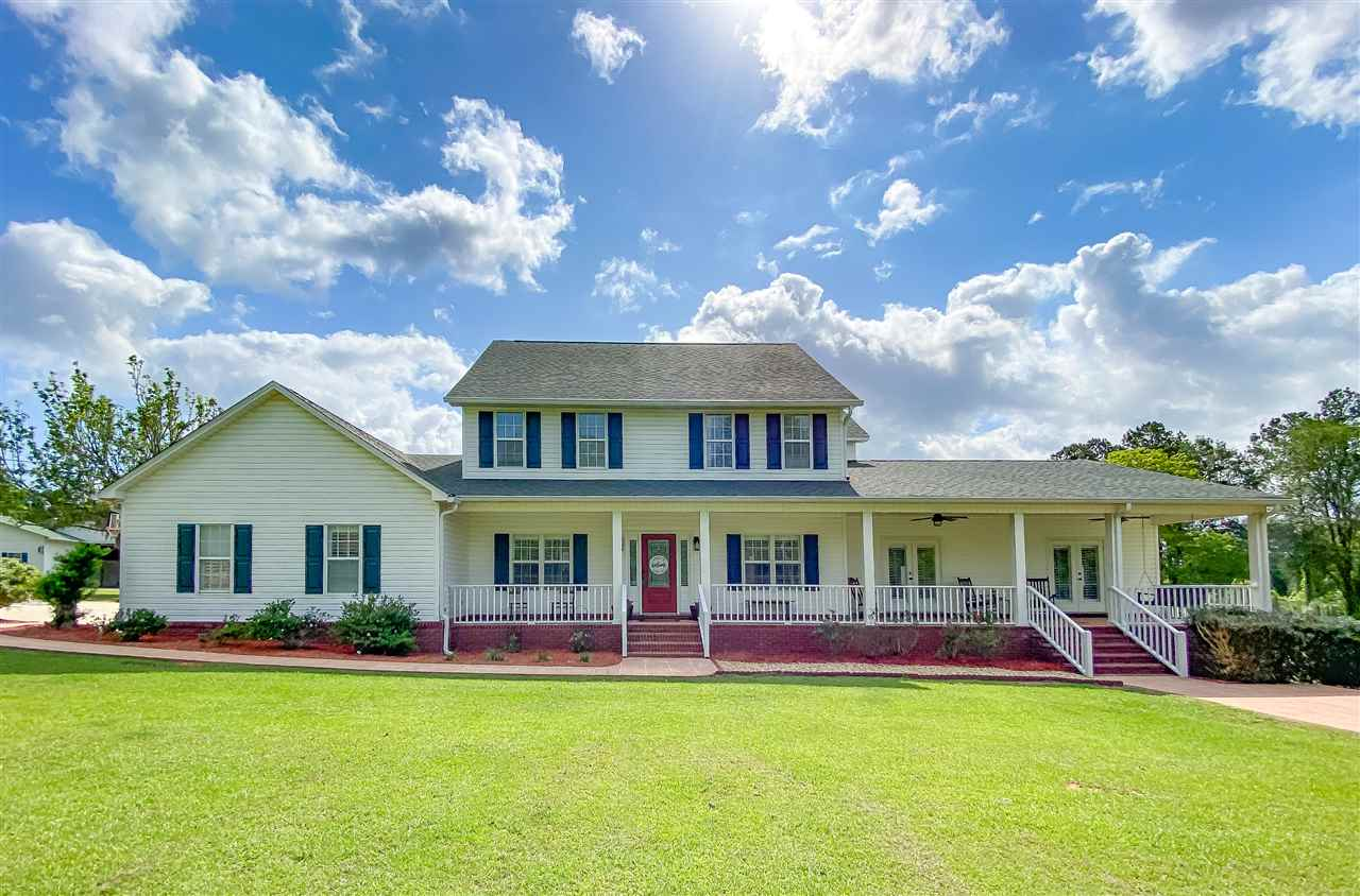 Welcome home to this picturesque farmhouse estate on acreage! No HOA! This home has been recently completely gutted and gorgeously renovated. Everything is new here! Ceilings, vanities, bathroom and kitchen fixtures, and so much more! Approaching the home down the long winding driveway, you'll notice a fantastic rocking chair front porch. The inside downstairs features a wide open floor plan with an eat in kitchen plus a formal dining area, a large family room with fireplace, a separate living room for the kids or office space, a dry bar with wine fridge, and a huge master suite large enough to situate office space or a reading nook/sitting area. This master suite opens up onto the rocking chair front porch through 2 sets of french doors. The master bath has double vanities and a large walk in shower with separate soaking tub. The master closet is fit for a queen and is a room in itself! Upstairs, we have 4 additional bedrooms and 2 bathrooms perfect for the kids or guests. New plantation shutters have been installed all throughout the home. Outdoors, we have 12.87 acres to roam with a fenced in area for animals, a huge barn with a pole barn off to the side for the RV/toys and metal building with 2 oversized roll up doors, and an adjoining 11.19 acres also available with this property for an additional price. Don't hesitate! Call to see this private slice of Heaven on the outskirts of Tallahassee today!