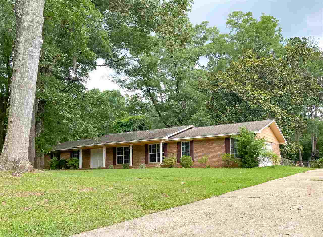 Fantastic 4 bedroom home on over an acre close in to town and in excellent school zones! Newer roof, HVAC, hot water heater, and stainless appliances. This renovated , spacious home has 4 true bedrooms, 2 living areas, 2 dining areas, a covered and screened back porch, huge back yard, 2 car garage, and so much more! Completely move-in ready and waiting for your family. Don't miss this one!