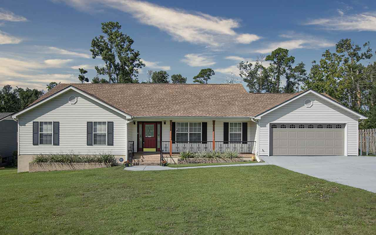 Well maintained, custom built, 1 story home. This beautiful home has many extras to make living here very easy. It won't disappoint.  A whole house Generac Generator, roof May of 2017, water heater 2015, the HVAC system also has a special allergy filtration system. Enjoy sitting on the back screened in porch, or sitting in front of the gas fireplace in the family room on those chilly nights. This property has a finished 2 car garage with cabinets, sink, refrigerator, stained wainscoting and an epoxy finish on the floor! If you need a workshop or storage there is a separate building in the back yard with electricity and a storage room or workshop underneath the house with electricity.  This property has so many extras! Near Lake Seminole, Camping, State Parks, and approximately 1.46 hours to Panama City Beach!